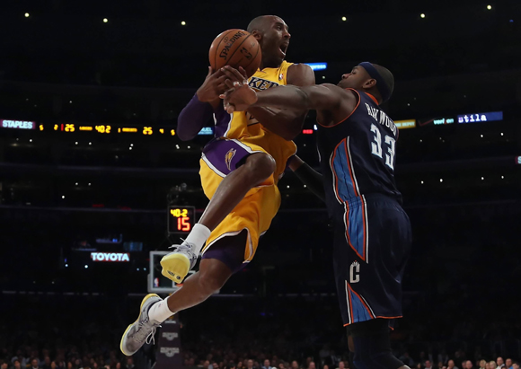 Kobe-Bryant-wears-Kobe-8-System-in-Grey-Purple-Gold-3