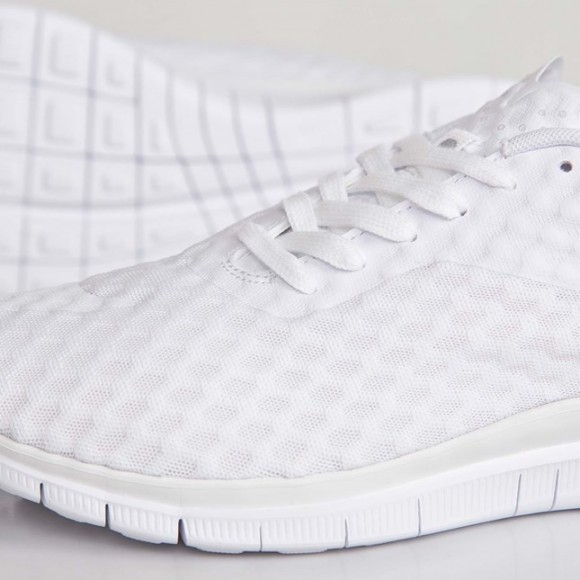 all-white Nike Free Hypervenom Low up close