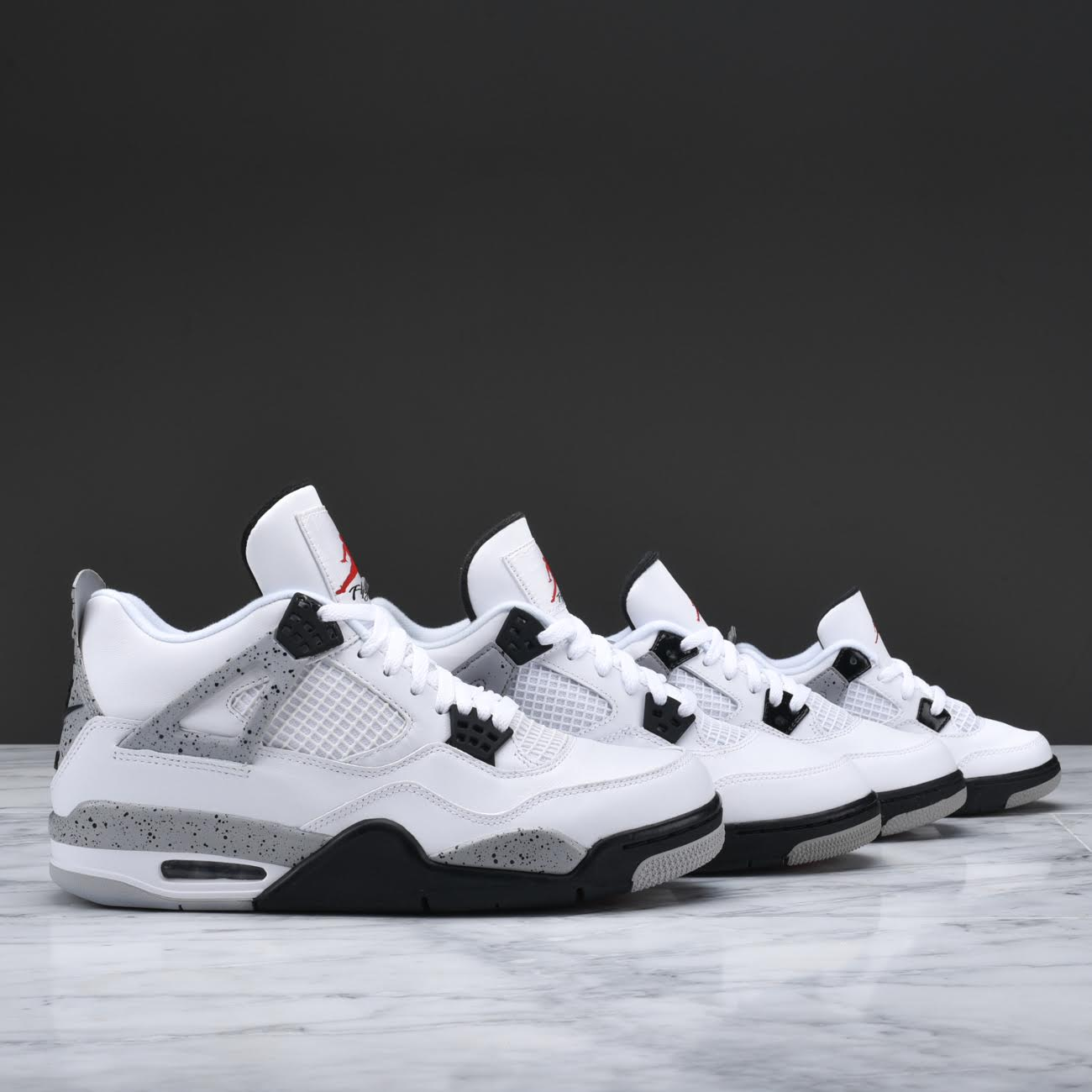 Your Best Look Yet at the Remastered Air Jordan 4 Retro in White: Cement 1
