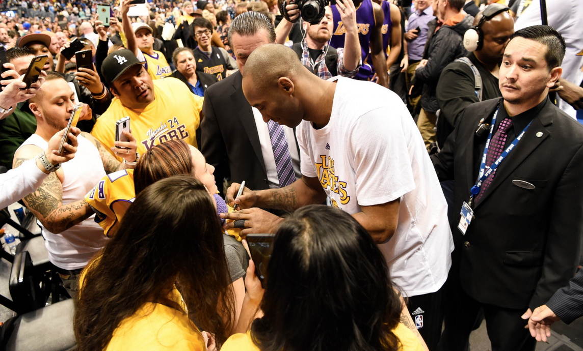 Kobe Gives a Young Fan a Signed Pair of PE's Right Off His Feet