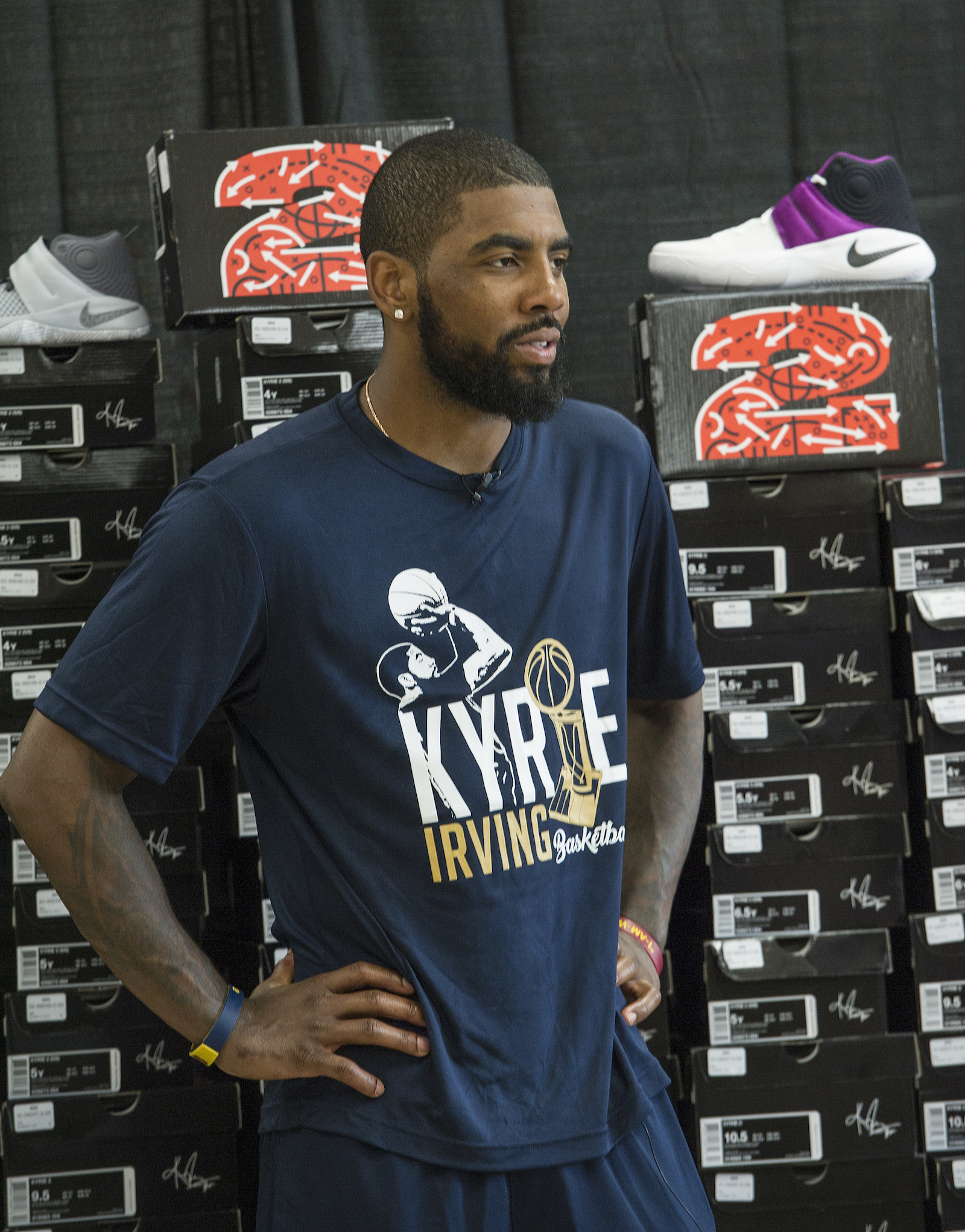Cleveland Cavaliers star Kyrie Irving, in partnership with Kids Foot Locker, donated 190 pairs of sneakers to Boys & Girls Clubs of Cleveland, Saturday, July 9, 2016, in Independence, Ohio. The donation matched Irving's 190 points scored during the NBA championship series.  (Phil Long/AP Images for Kids Foot Locker)