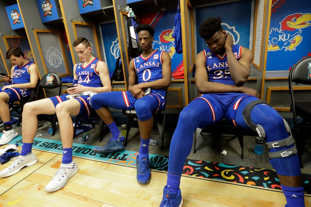 college basketball scandal adidas kansas jayhawks