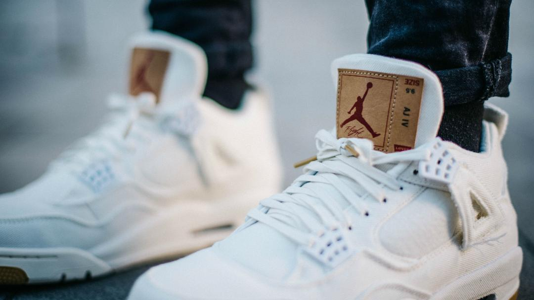 levis air jordan 4 white on foot